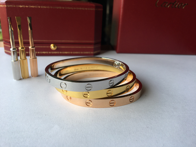 Cartier love bracelet white gold, yellow gold and pink gold